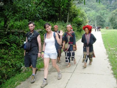 Tourists tramp around Ta Phin Village in Sapa Town