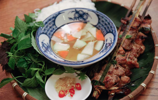 Vermicelli and grilled chopped meat in bamboo sticks