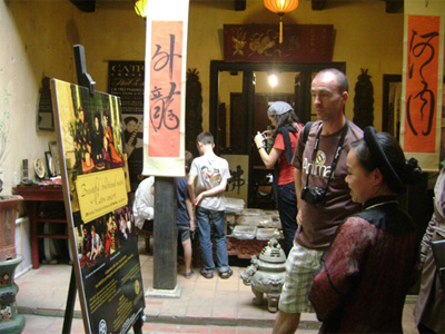 Tourists visit the ancient house at 87 Ma May, Hanoi.