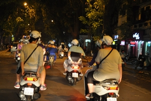 Hanoi on scooter at night