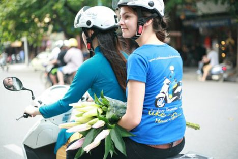 Hanoi on scooter at night - Vietnam Paradise Travel